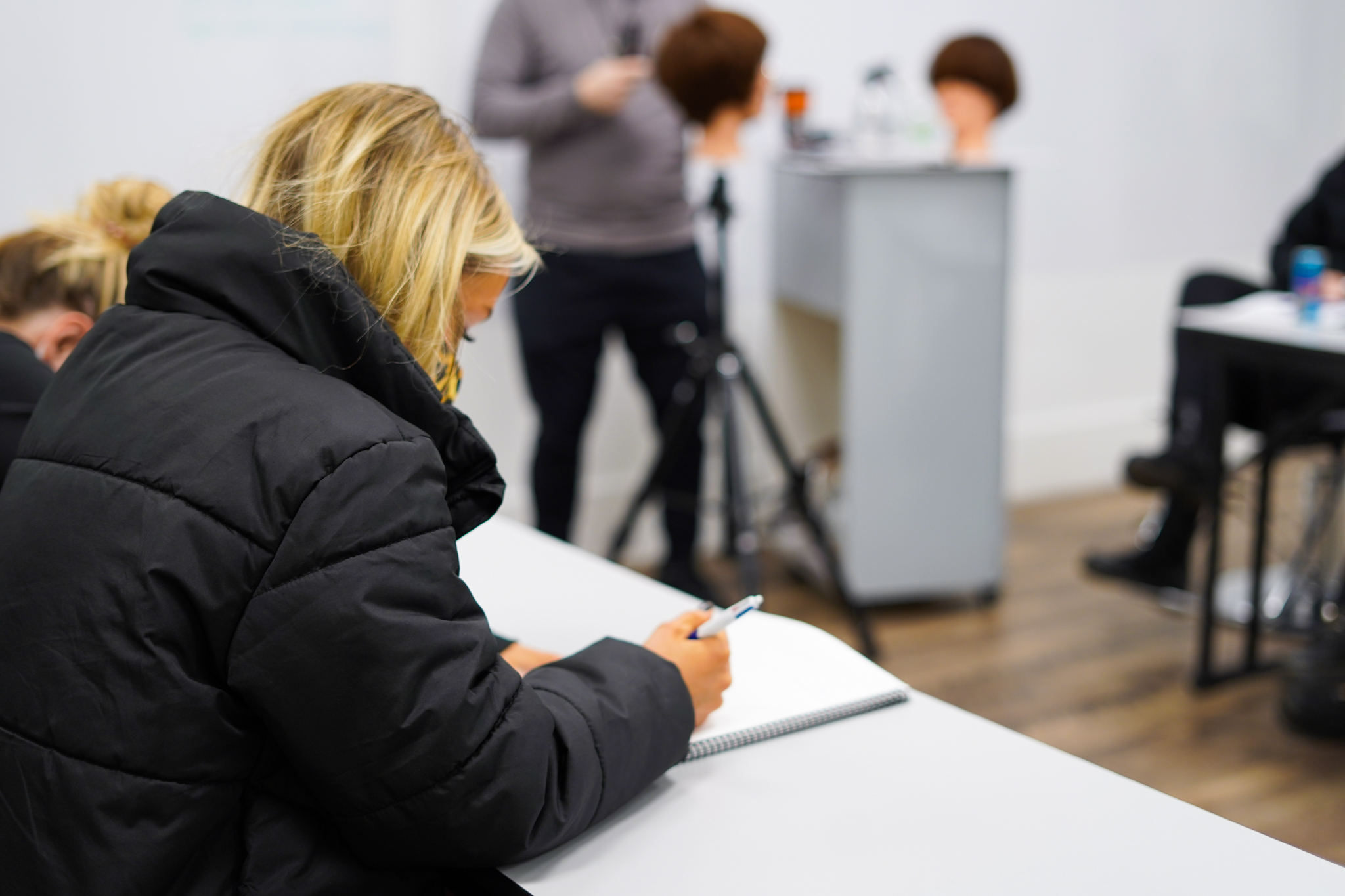 woman taking notes in class at collectiv academy