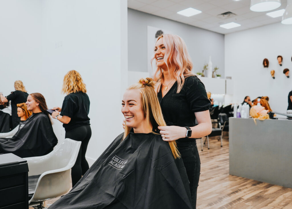 A stylist smiling with her client